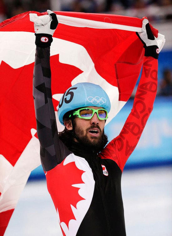 Charles Hamelin takes a victory lap with the Maple Leaf.